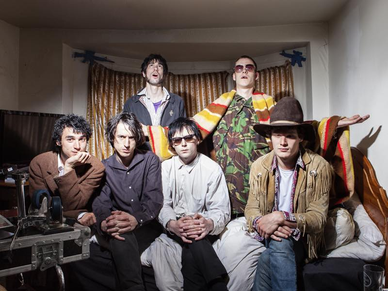 Fat White Family sign with Domino