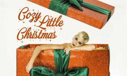 Katy gets cosy with Santa