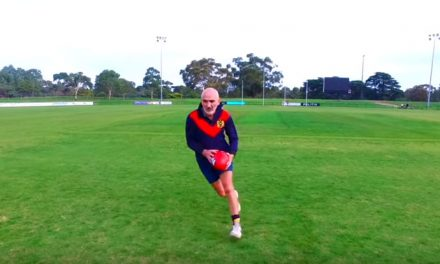 Paul Kelly wears childhood footy jumper in clip for new single 'Hummin' to Myself'