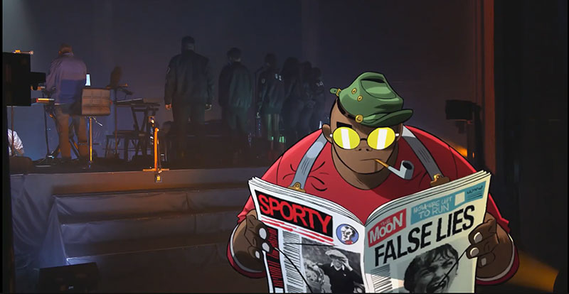 Russell from Gorillaz reading a newspaper