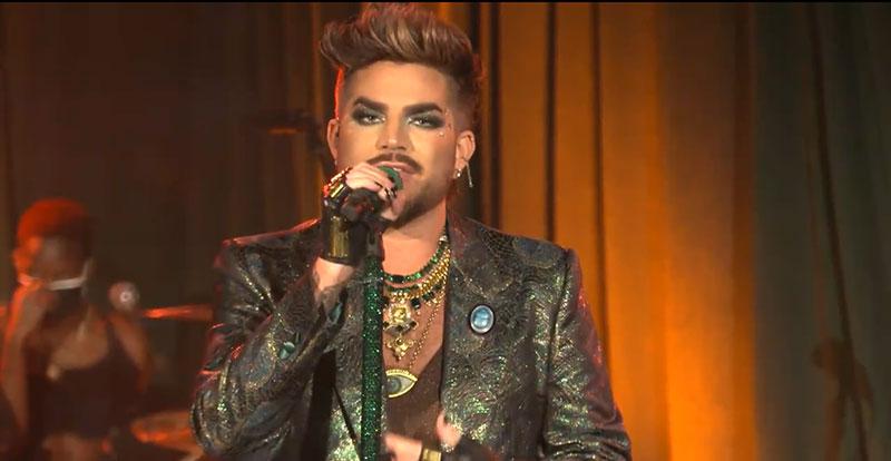 Singer Adam Lambert holding a microphone