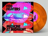 Album cover artwork and orange vinyl for Foo Fighters album Medicine at Midnight