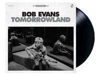 Album cover artwork for Tomorrowland with black vinyl record popping out