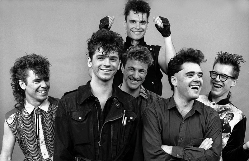 The six bandmembers of INXS, cavorting