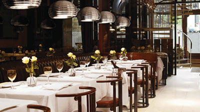 Silver service dining room with row of tables