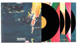 Deluxe vinyl album artwork with four LPs popping out