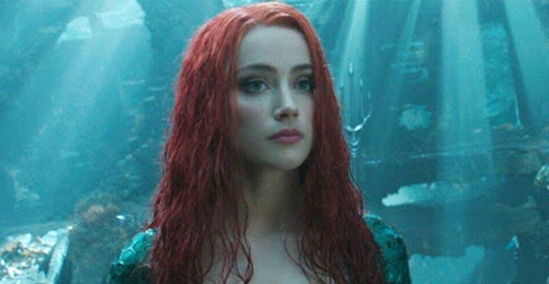Amber Heard does Aquaman training victory dance