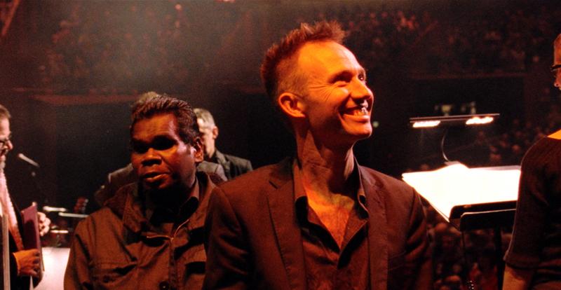 Two men smiling at audience