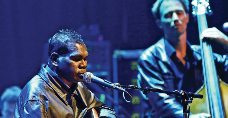 Two musicians performing on stage