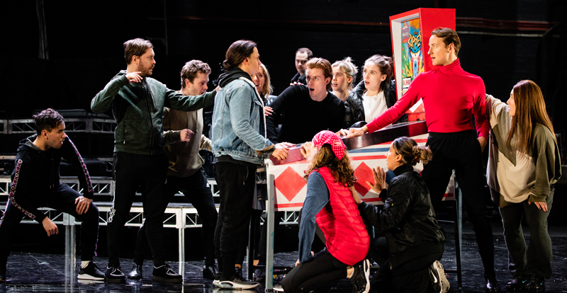 The Who's Tommy cast rehearsing on stage