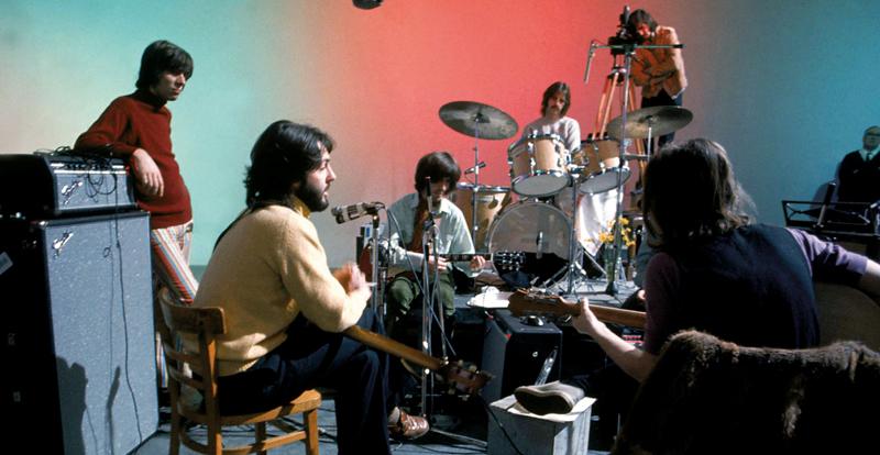Four musicians practsing in a studio